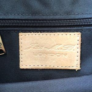 Jas M. B. Bags - Black messenger bag with distressed finish.